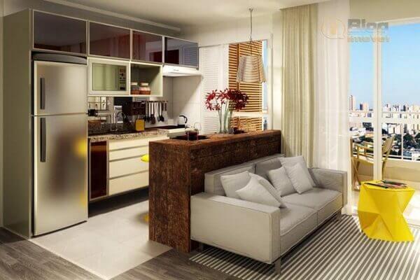 Ideia de decoração de sala com cozinha