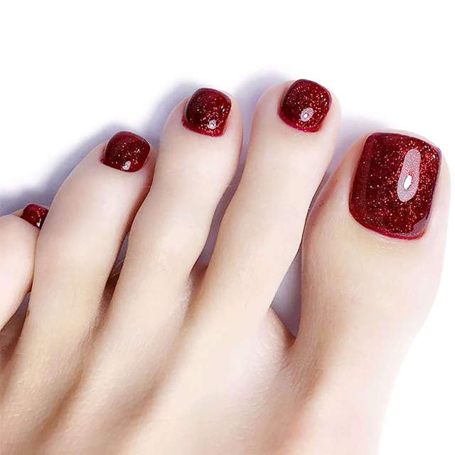 Unha do pé vermelha