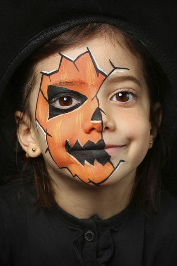criança com maquiagem de abóbora