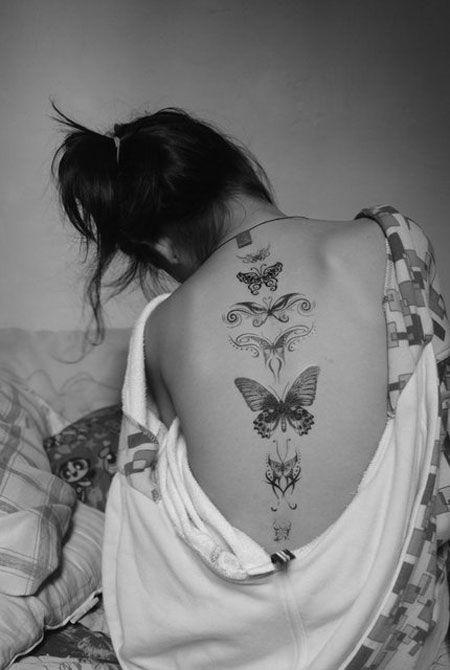 tatuagem nas costas de borboleta